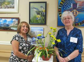 Crossroads of Hughesville Garden Club member, Teresa Grimes, created a beautiful floral interpretation of art displayed by Nancy Owens.