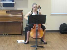 Tyler Alo, the daughter of one of our artists featured in the exhibit, plays cello during the reception