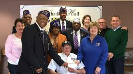 Left to right:  Daughter Jerri Persinger; Commander of MOPH Department of Maryland Al Hammock, Jr,; Commander of MOPH Chapter 2222 Richard Hollis; Ladies MOPH Florida Chapter 823 Emorris E. Cook-Jordan; Chapter 2222 Chaplain Cornell Rogers Ford; Resident Bill Young; Chapter 2222 Sergeant-At-Arms Ransom Jordan, Jr; daughter-in-law Karen Young; Charlotte Hall Veterans Home Director Sharon Mattia; son Rick Young; son John Young.