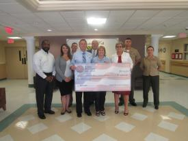 Pictured left to right:  Dwight Belin, NAVAIR Deputy PEO-W/L; Ashley Radano, CHVH Director of Volunteer and Community Outreach; Scotty Roland, Program Manager, Synectic Solutions, Inc.; Fred Jones, NAVAIR PEO-W/L; Ray Rowland, OPNAV; Sharon Murphy, Director of Veterans Home Program; Ellen Bailey, BFM PEO W/L; Lt. Col. Josh Roberts, HQMC; and Major Leah Parrott, OPNAV.
